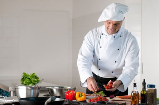 Chef washing and preparing salad vegetables
